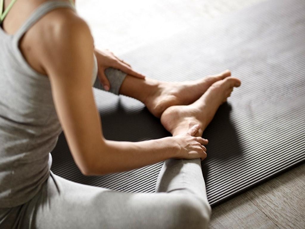 Yoga_pilates_student_on_mat_sml